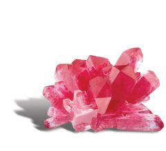 Avattu pakkaus sisältää kasvatusjauheen, kolme eri värijauhetta, muovipurkin ja annostelulusikan.