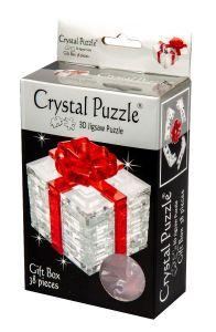 Kolmiulotteinen lahjapaketti lahjanarulla palapeli. Lahjapaketti on väriltään vaalea/läpinäkyvä. Lahjanaru on väriltään punainen.
