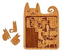 Neliön muotoinen puinen alusta jonka sisällä erilaiset suloiset kissapalat.